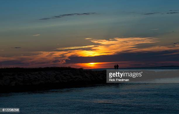 Sunset over Menemsha Sound in the town of Chilmark on Martha's Vineyard MA over looking beach in the town of Aquinnah formerly known at Gay Head on...