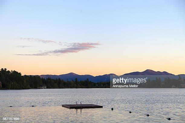 sunset over mirror lake in the lake placid area - mirror lake stock pictures, royalty-free photos & images