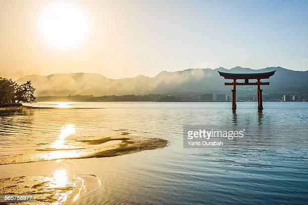 Sunset over Miyajima great torii gate Itsukushima