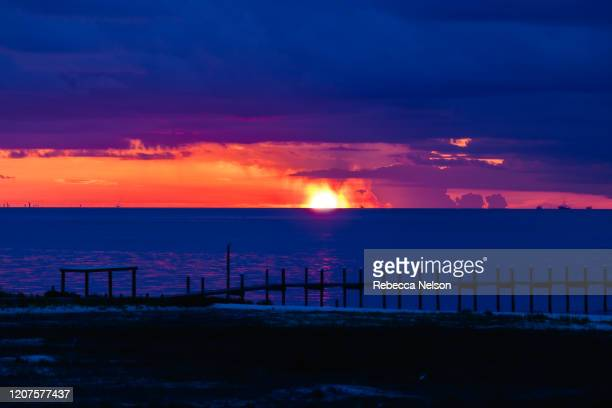 sunset over mobile bay - rebecca nelson stock pictures, royalty-free photos & images