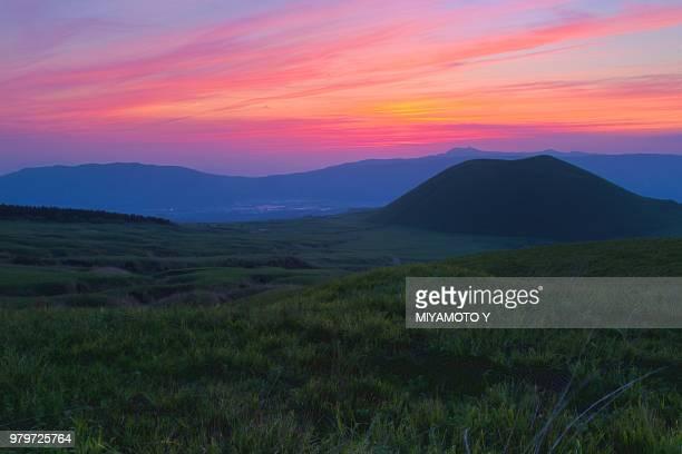 sunset over mount aso, kumamoto prefecture, japan - miyamoto y ストックフォトと画像
