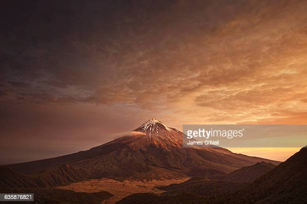 sunset over mountain - brown stock pictures, royalty-free photos & images