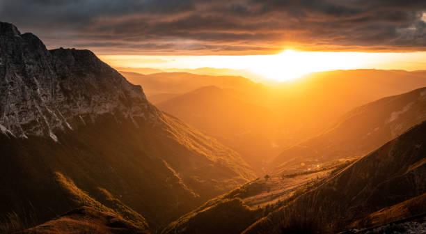 Sunset over mountain valley, Bolognola, Marche, Italy