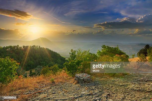 sunset over mountains - emilia romagna stock photos and pictures