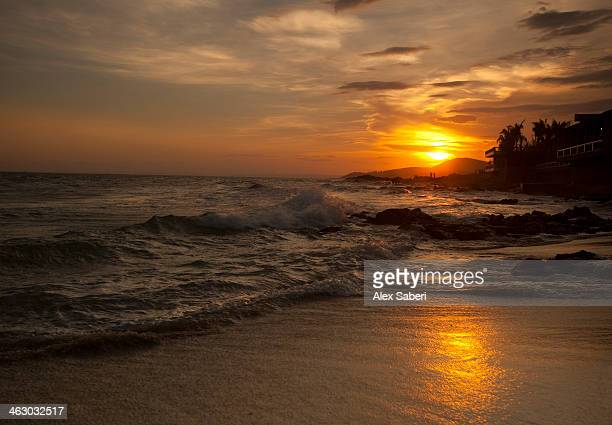 sunset over mui ne beach. - alex saberi stock pictures, royalty-free photos & images