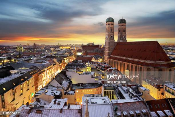 sunset over munich's skyline - münchen stock-fotos und bilder
