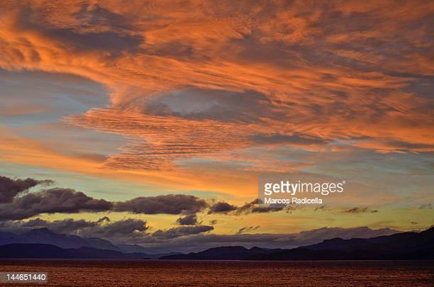 sunset over nahuel huapi lake - radicella stock pictures, royalty-free photos & images
