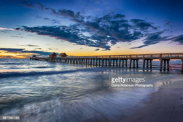 sunset over naples pier, naples, florida - naples florida stock pictures, royalty-free photos & images