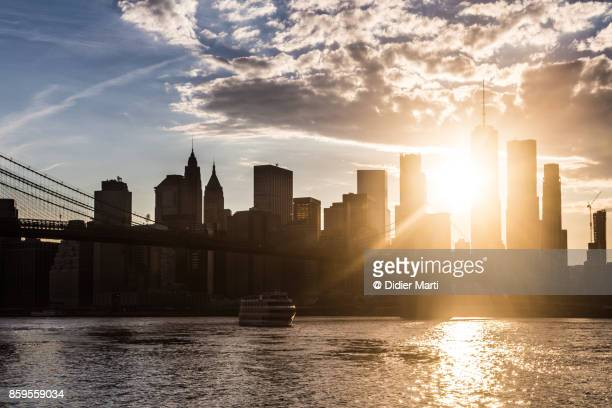sunset over new york city manhattan financial district - didier marti stock photos and pictures