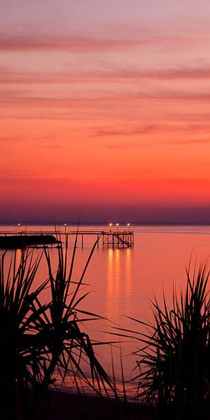 Sunset over Night cliff Jetty