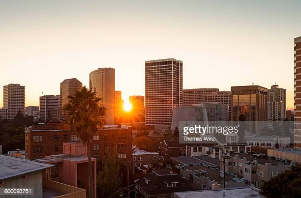sunset over oakland skyline - oakland california skyline stock pictures, royalty-free photos & images