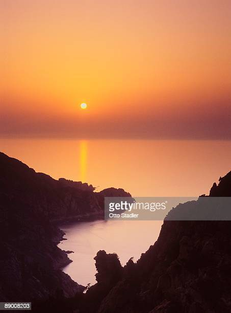 sunset over ocean, calanques, piana, corsica, france - calanques stock pictures, royalty-free photos & images