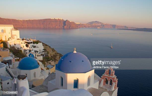 sunset over oia and fira - golden hour stock pictures, royalty-free photos & images