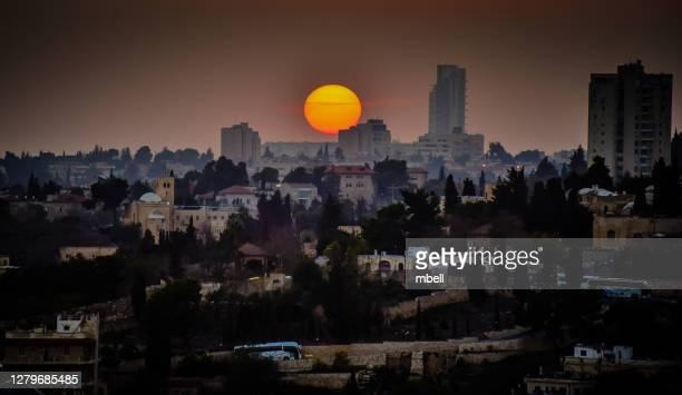 sunset over old town jerusalem viewed from mount of olives - jerusalem israel - mount of olives stock pictures, royalty-free photos & images