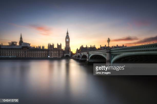 sunset over palace of westminster in london, england, uk - image stock pictures, royalty-free photos & images