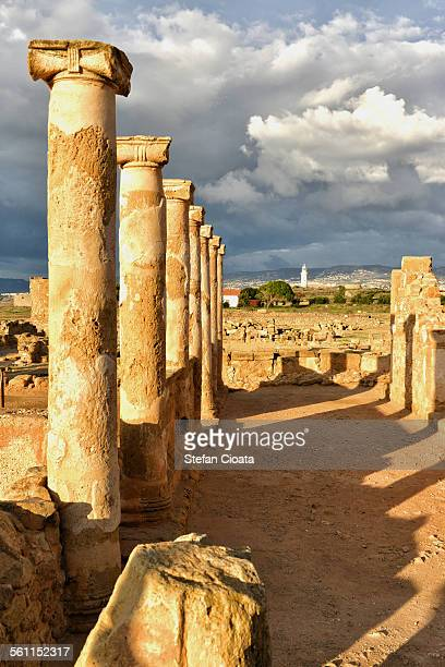 sunset over paphos archeological site - パフォス ストックフォトと画像