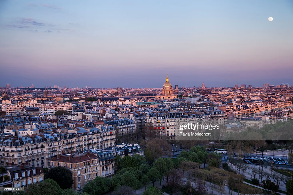Sunset over Paris with full moon : Stock Photo
