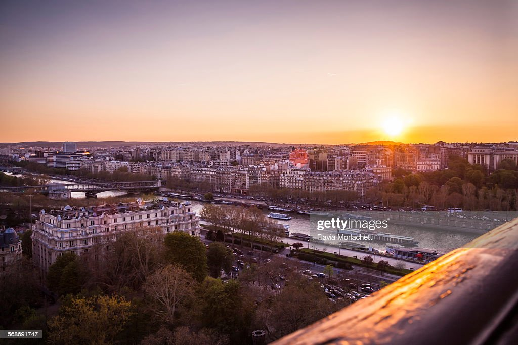 Sunset over Paris with the Seine river : Stock Photo