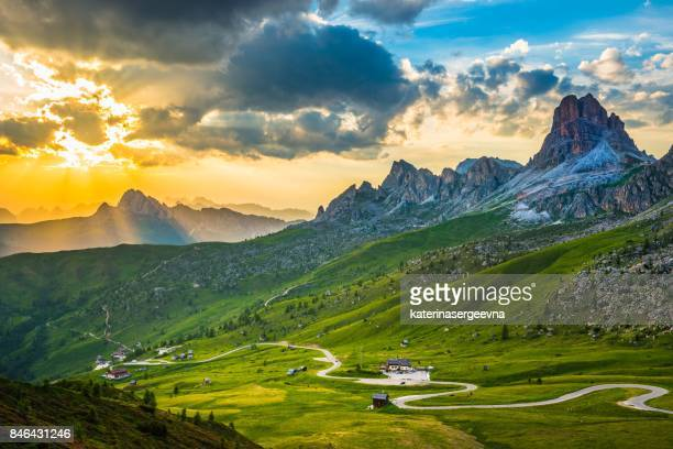 sunset over pass giau. dolomites alps. italy - european alps stock photos and pictures