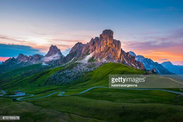 sunset over pass giau. dolomites alps. italy - mountain peak stock pictures, royalty-free photos & images