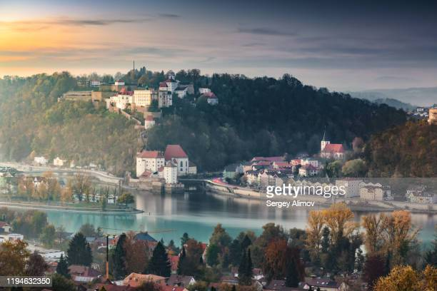 sunset over passau city and ilz, inn and danube rivers estuary - german culture stock pictures, royalty-free photos & images