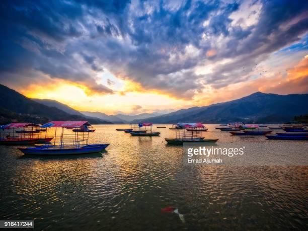 sunset over phewa lake, pokhara, nepal - march 9, 2017 - kathmandu stock pictures, royalty-free photos & images