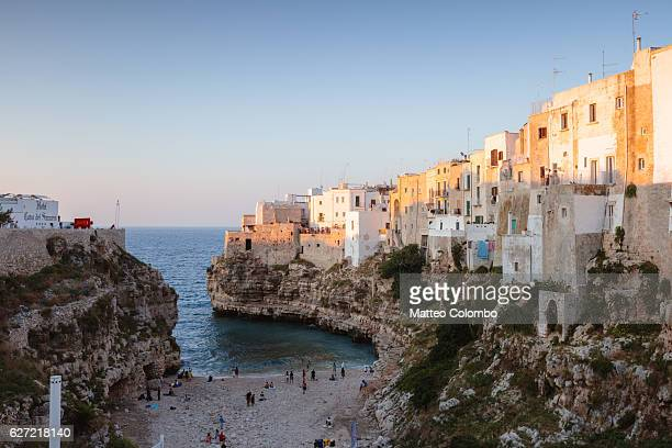 Sunset over Polignano a mare and beach, Apulia, Italy