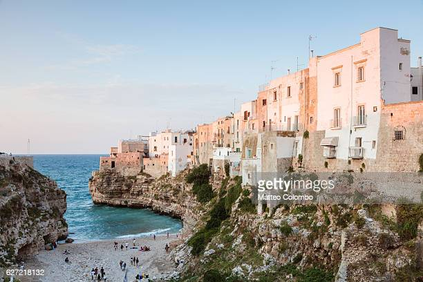 sunset over polignano a mare, apulia, italy - polignano a mare stock photos and pictures