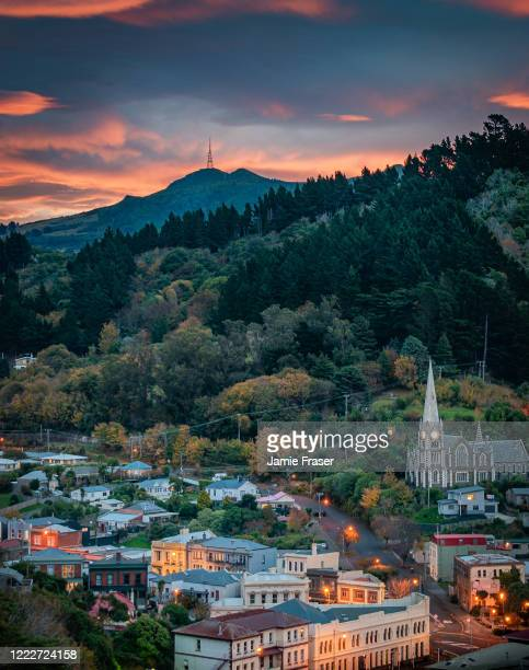sunset over port chalmers and mount cargill - dunedin new zealand stock pictures, royalty-free photos & images