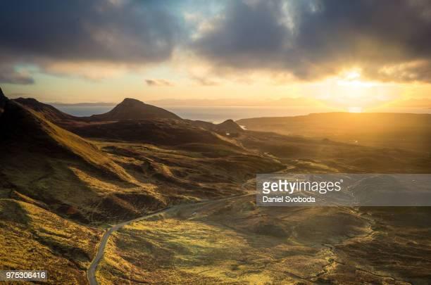 sunset over quirang massiv, isle of skye, scottish highlands, scotland, uk - scotland stock pictures, royalty-free photos & images