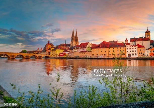sunset over regensburg - レーゲンスブルク ストックフォトと画像