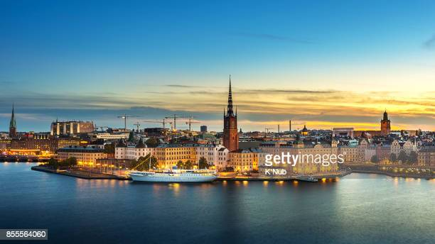 sunset over riddarholmen chruch in old town stockholm city, sweden - stockholm stock pictures, royalty-free photos & images