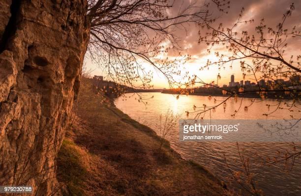 sunset over river, edmonton, alberta, canada - edmonton stock pictures, royalty-free photos & images