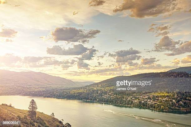 sunset over rolling hills and lake with water ski - kelowna stock pictures, royalty-free photos & images