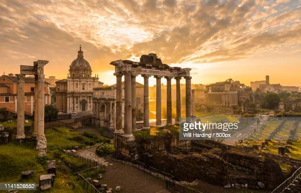 sunset over roman forum ruins - roman forum stock pictures, royalty-free photos & images