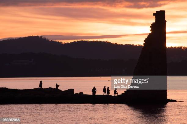 sunset over san sardonino tower - pontevedra province stock photos and pictures