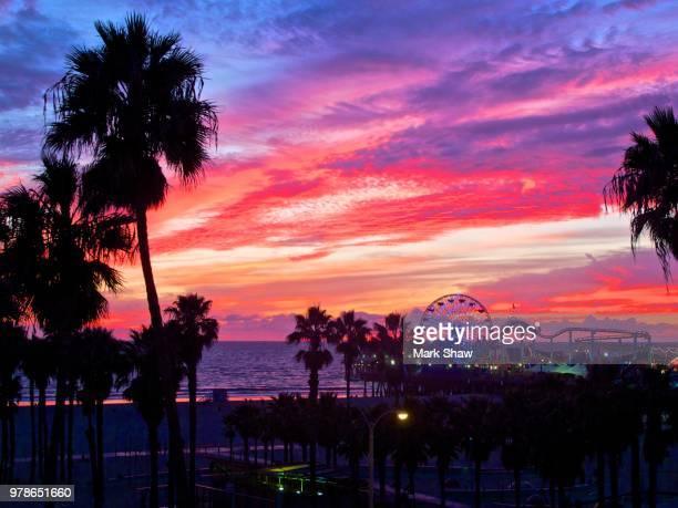 sunset over santa monica pier area, california, usa - santa monica stock pictures, royalty-free photos & images