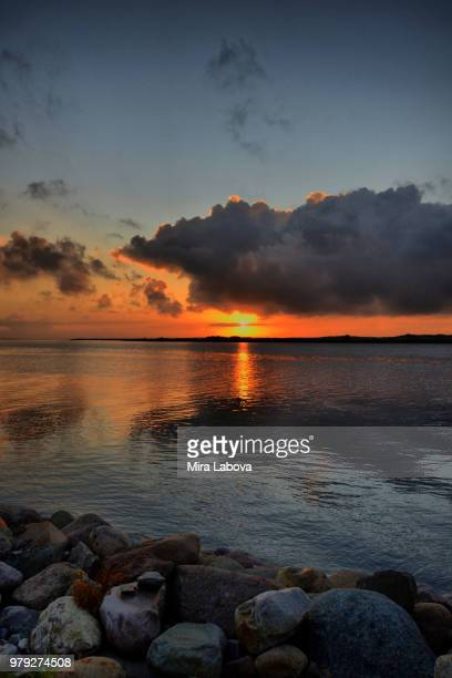 Sunset over sea and rocky coastline, Aalborg, Denmark