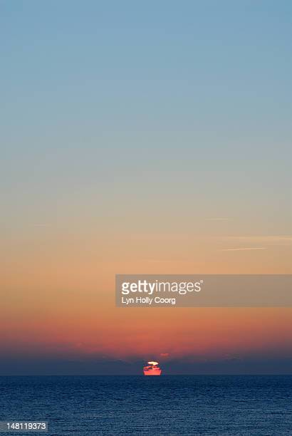 sunset over sea in cyprus - lyn holly coorg stock photos and pictures