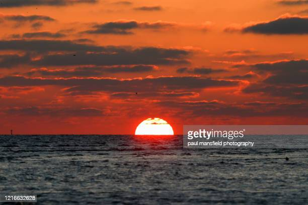 sunset over sea - west sussex stock pictures, royalty-free photos & images