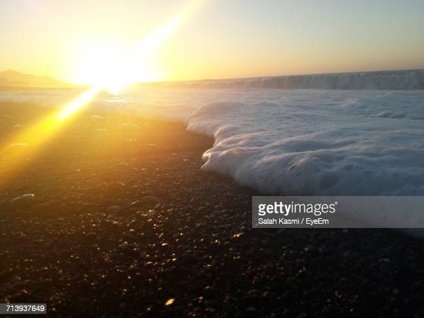 sunset over sea - salah stock photos and pictures