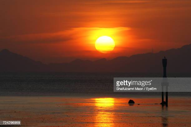 sunset over sea - shaifulzamri stock pictures, royalty-free photos & images