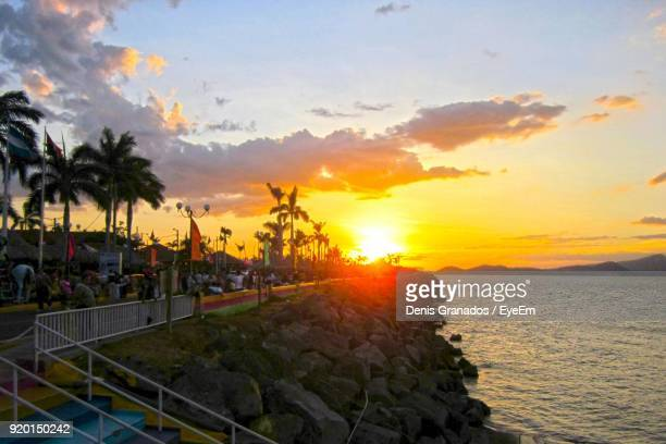 sunset over sea - managua stock pictures, royalty-free photos & images