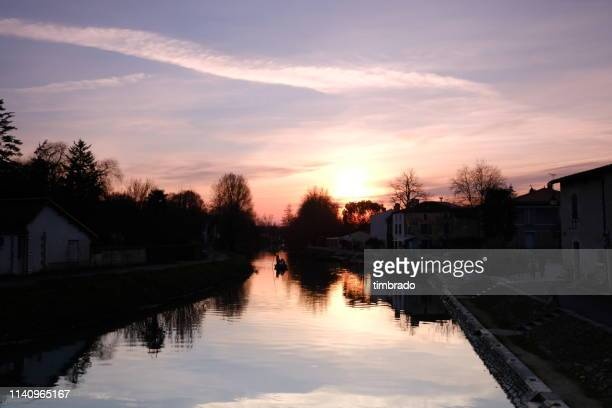 sunset over sevre niortaise river, deux-sevres, france - deux sevres stock photos and pictures