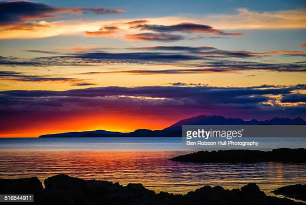 sunset over skye as viewed from mallaig - mallaig stock photos and pictures