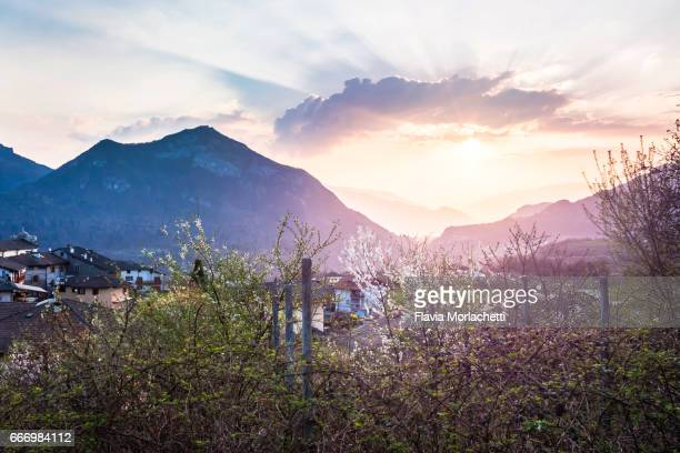 Sunset over small village in Italy