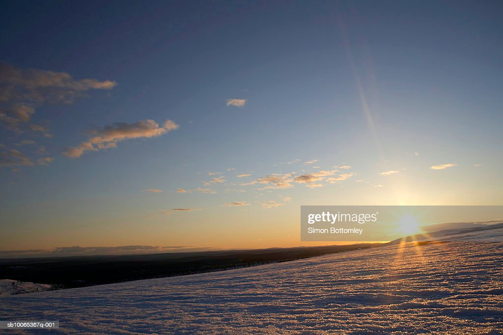 Sunset over snow covered mountain : Foto stock