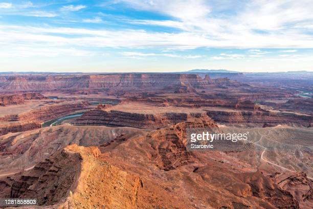 sunset over southwest usa desert landscape - colorado river utah - rock formation stock pictures, royalty-free photos & images