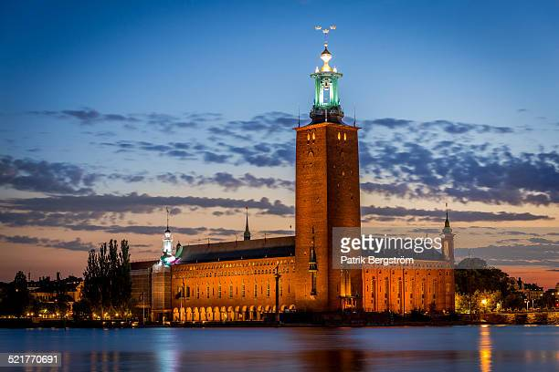 sunset over stockholm city hall - nobel prize stock pictures, royalty-free photos & images