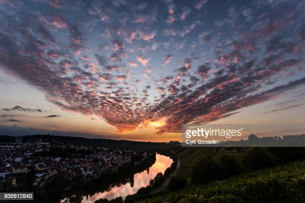 sunset over stuttgart münster and the river neckar - spiegelung stock pictures, royalty-free photos & images